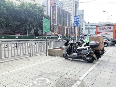 郑州电动车停放区全部变成收费?这种情况可举报